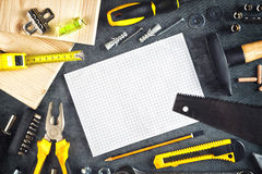 Assorted lo hace usted mismo las herramientas y cuaderno Imágenes de archivo libres de regalías