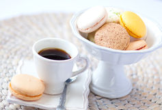 Assorted macarons and a cup of coffee Royalty Free Stock Photos