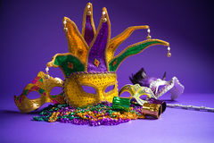 Assorted Mardi Gras or Carnivale mask on a purple background Stock Image