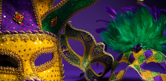 Assorted Mardi Gras or Carnivale mask on a purple background. Festive Grouping of mardi gras, venetian or carnivale mask on a purple background stock photo