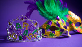 Assorted Mardi Gras or Carnivale mask on a purple background Royalty Free Stock Photo