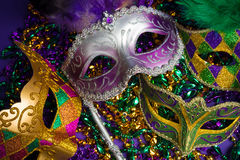 Assorted Mardi Gras or Carnivale mask on a purple background. Festive Grouping of mardi gras, venetian or carnivale mask on a purple background