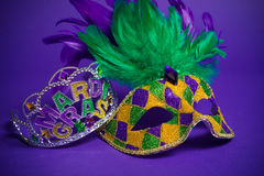 Assorted Mardi Gras or Carnivale mask on a purple background. Festive Grouping of mardi gras, venetian or carnivale mask on a purple background stock photography