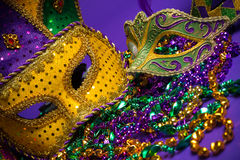 Assorted Mardi Gras or Carnivale mask on a purple background. Festive Grouping of mardi gras, venetian or carnivale mask on a purple background stock images