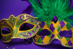 Assorted Mardi Gras or Carnivale masks on purple. Festive Grouping of mardi gras, venetian or carnivale masks on a purple background royalty free stock photos