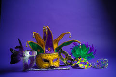 Assorted Mardi gras mask on purple background Stock Photography