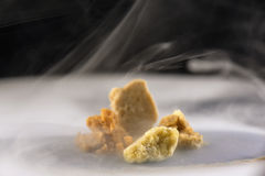 Assorted Marijuana Extraction Concentrate Aka Wax Crumble On Smoky Background Royalty Free Stock Image