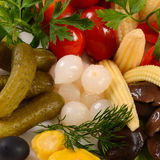 Assorted marinated vegetables and mushrooms. Close up Stock Photos