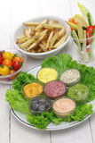 Assorted mayonnaise sauce with french fries and raw vegetables Stock Photos
