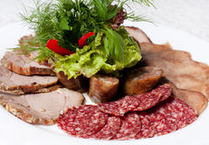 Assorted meat. With herbs. Cold appetizer Stock Photography