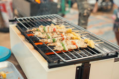 Assorted meat from chicken and pork and various vegetables on barbecue grill cooked. Royalty Free Stock Photography
