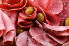 Assorted Meat delicatessen. Background of Assorted Meat delicatessen and olives Stock Image