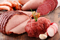 Assorted meat products including ham and sausages Stock Image