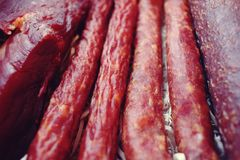 Assorted meat products including ham and sausages. Royalty Free Stock Images