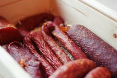 Assorted meat products including ham and sausages. Stock Image