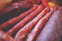 Assorted meat products including ham and sausages. Royalty Free Stock Photos