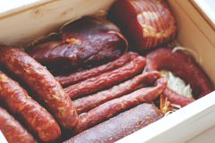 Assorted meat products including ham and sausages. Royalty Free Stock Photography