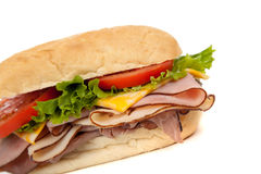 Assorted meat sandwich with fixings on a hoagie Stock Photography
