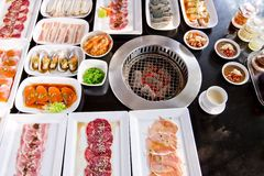 Assorted meat and seafood uncooked and roaster ready to be grill Royalty Free Stock Photography