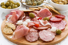 Assorted meat snacks, sausages and pickles, close-up Stock Photos