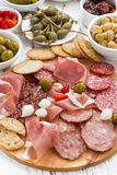 Assorted meat snacks, sausages and pickles, top view, close-up Royalty Free Stock Photo
