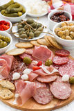 Assorted meat snacks, sausages and pickles, vertical, close-up Royalty Free Stock Images