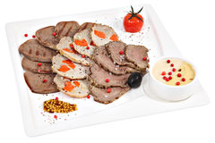 Assorted meat on a square serving plate,  studio shot. Royalty Free Stock Image