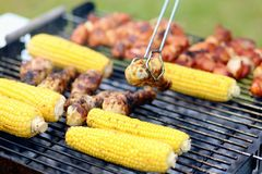 Assorted meat and vegetables on barbecue gril royalty free stock photo