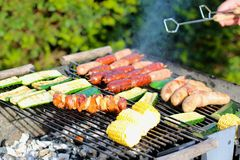 Assorted meat and vegetables on barbecue gril Stock Photography