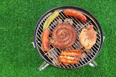 Assorted Meet Products On Hot BBQ Grill. High Angle View royalty free stock photos