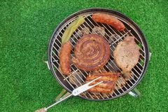 Assorted Meet Products On Hot BBQ Grill. High Angle View Royalty Free Stock Images