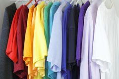 Assorted Mens Shirts. Variety of shirts for a man to wear in a many different colors and styles hanging in a closet Stock Photography