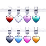 Assorted metal charm heart pendants. Royalty Free Stock Photos