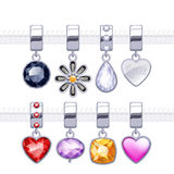 Assorted metal charm pendants. Royalty Free Stock Photo