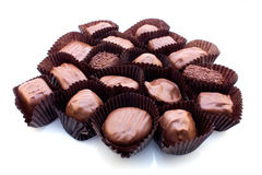 Assorted milk chocolate. On white background Royalty Free Stock Photo