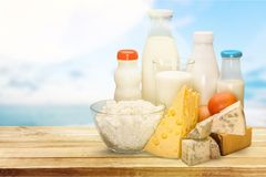 Assorted milk products on wooden table on natural stock photos