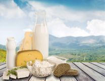Assorted milk products on wooden table on natural stock image