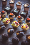 Assorted mini cakes on the table Stock Photo