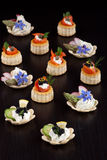 Assorted Mini Canapes over black Stock Photos