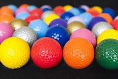 Assorted Mini Golf Balls. Assortment of colorful mini golf balls on black Royalty Free Stock Photos