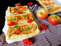 Assorted mini-tarts. Mini-tarts made of puff pastry with assorted fillings stock image