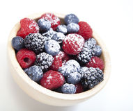 Assorted mixed berries in a bowl stock photos