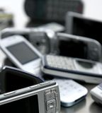 Assorted mixed mobile phones. Old, new technology in cell telephones Stock Photo