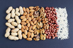 Assorted mixed nuts, peanuts, almonds, walnuts and sesame seeds. Royalty Free Stock Photography