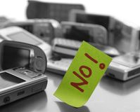 Assorted mobile phones and written word: NO royalty free stock photo