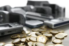 Assorted mobile phonesand Euro coins Royalty Free Stock Photos
