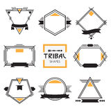 Assorted modern tribal out line shapes, labels and emblems set Stock Image