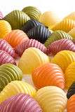 Assorted multi colored pasta. On white Stock Photos