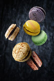 Assorted multi flavoured macaroons floating Royalty Free Stock Photography