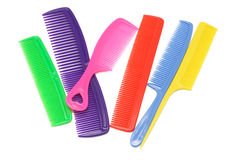 Assorted multicolor plastic combs. On white background Royalty Free Stock Photo